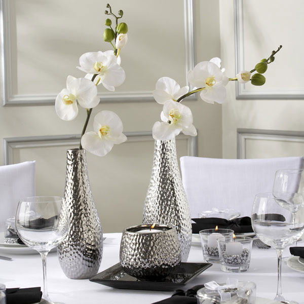 The white orchid is the center piece of the table decoration orchid wedding